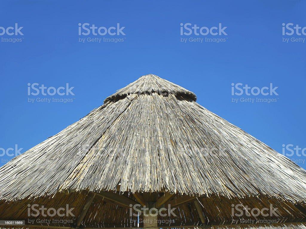 Bamboo beach umbrella closeup royalty-free stock photo