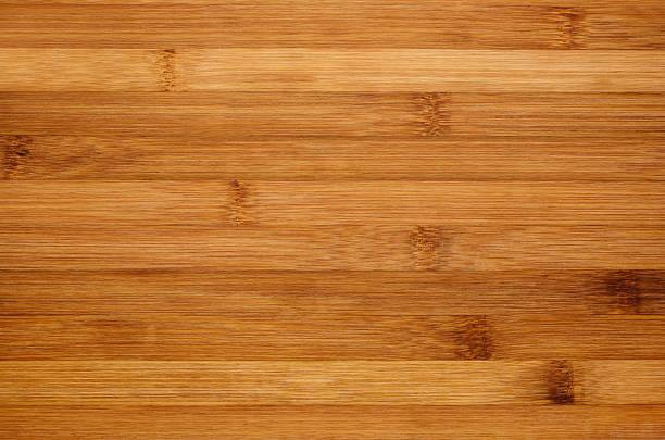 Bamboo brown wood texture, horizontal plank, top view, closeup. Bamboo brown wood texture, horizontal plank, top view, closeup. bamboo material stock pictures, royalty-free photos & images