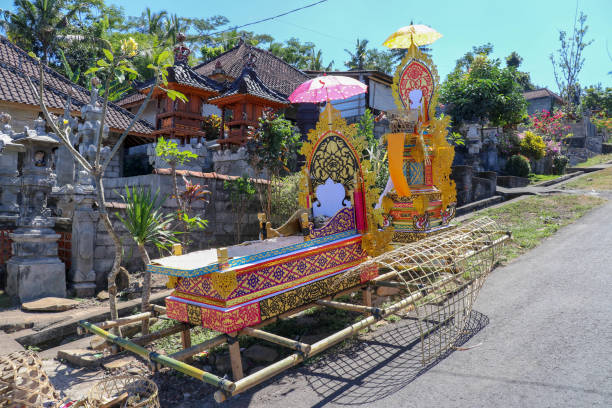 Bamboo burial litter. During the funeral ritual, Hindu believers consider the body of the deceased to be bier. Multicolored design with symbols. Faith and cremation on Bali island Bamboo burial litter. During the funeral ritual, Hindu believers consider the body of the deceased to be bier. Multicolored design with symbols. Faith and cremation on Bali island. deathly stock pictures, royalty-free photos & images