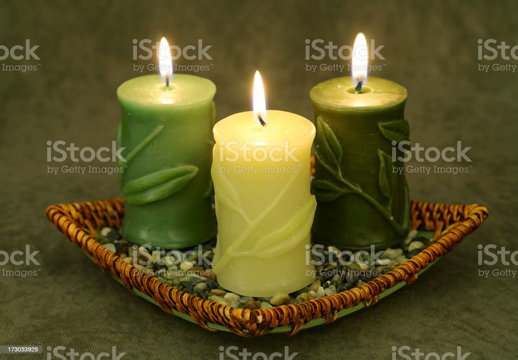 Bamboo Candle Trio in basket stock photo
