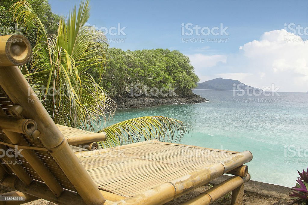 Bamboo chair on a beach royalty-free stock photo