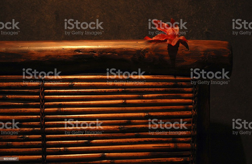 Bamboo chair with maple leaf and soft lighting royalty-free stock photo