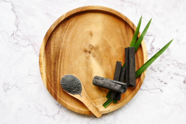 Bamboo charcoal and powder on marble table. copy space stock photo