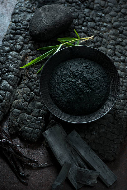 bamboo charcoal powder - carbon stock-fotos und bilder