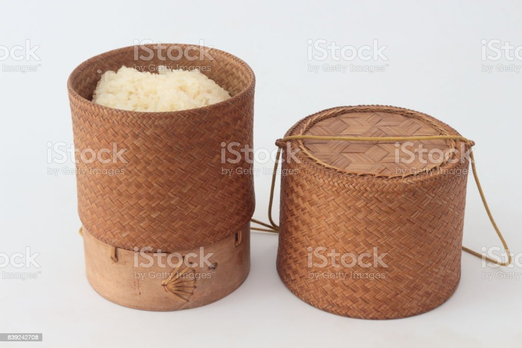 bamboo container for holding cooked glutinous rice. stock photo