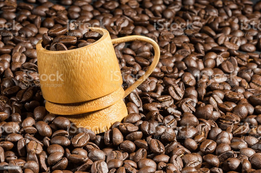 bamboo cup on coffee bean texture stock photo