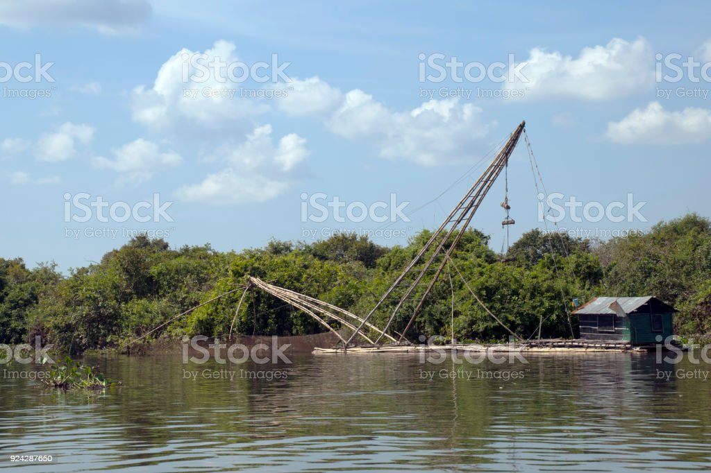 Bamboo fishing raft with cantilever net and hut stock photo