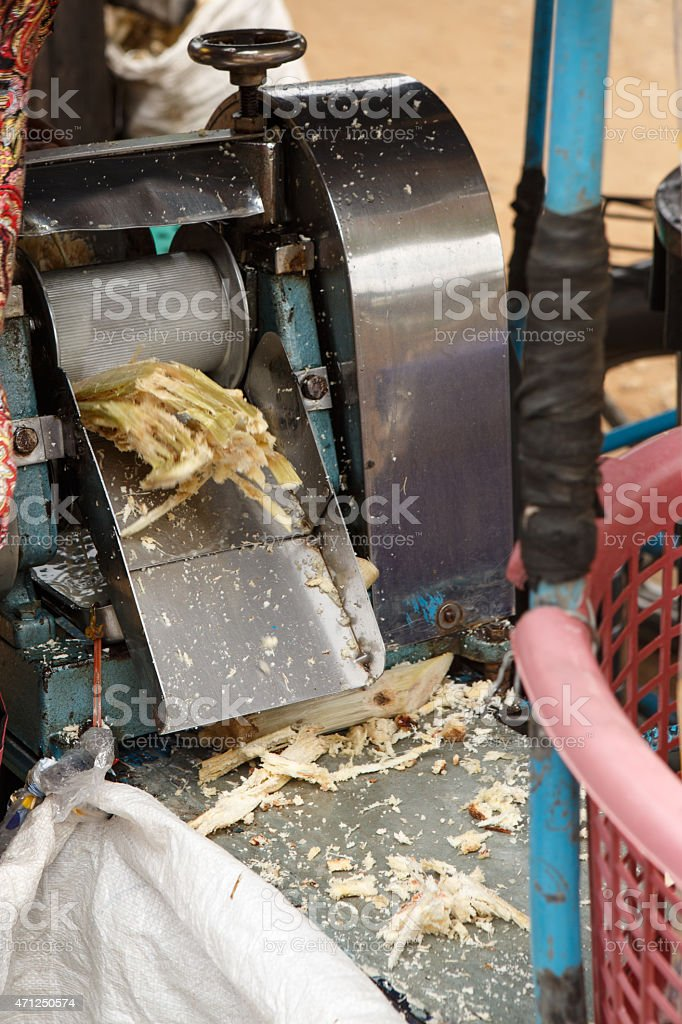 Bamboo is pressed to make a drink. stock photo