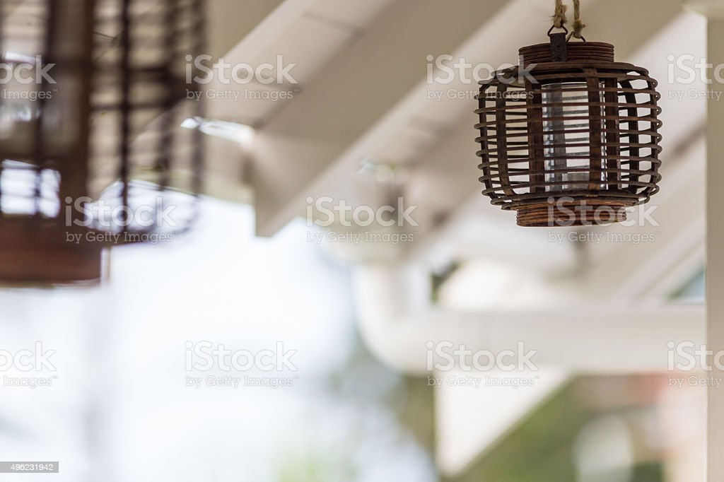 Bamboo lantern lightbulb stock photo