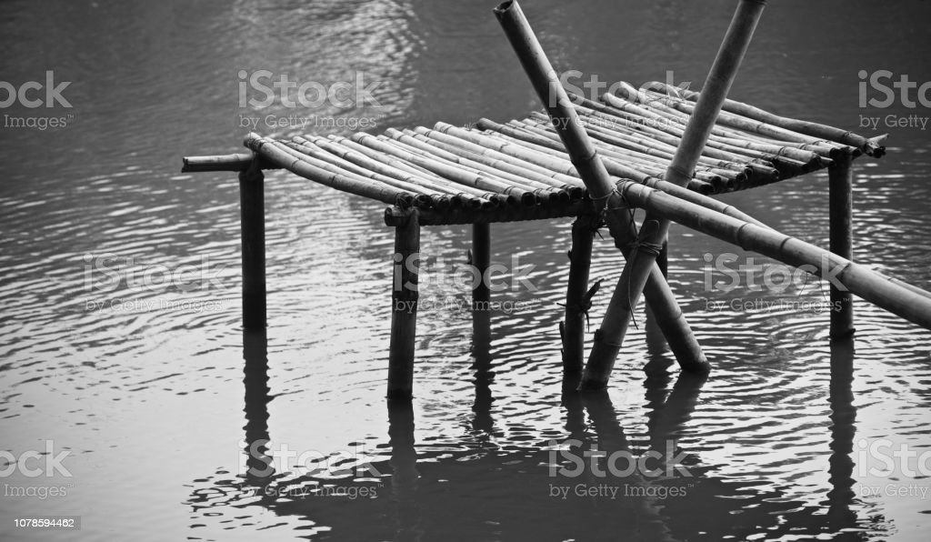 A bamboo made structure in a pond unique photo stock photo