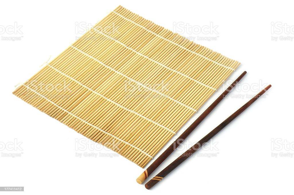 Bamboo mat with chopstick stock photo