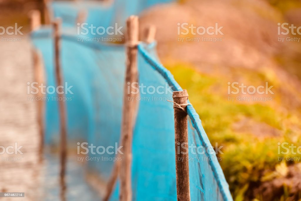 Bamboo objects with blue nylon nets unique blurry photo stock photo