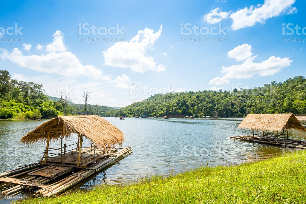 Bamboo raft, floating house in lake stock photo