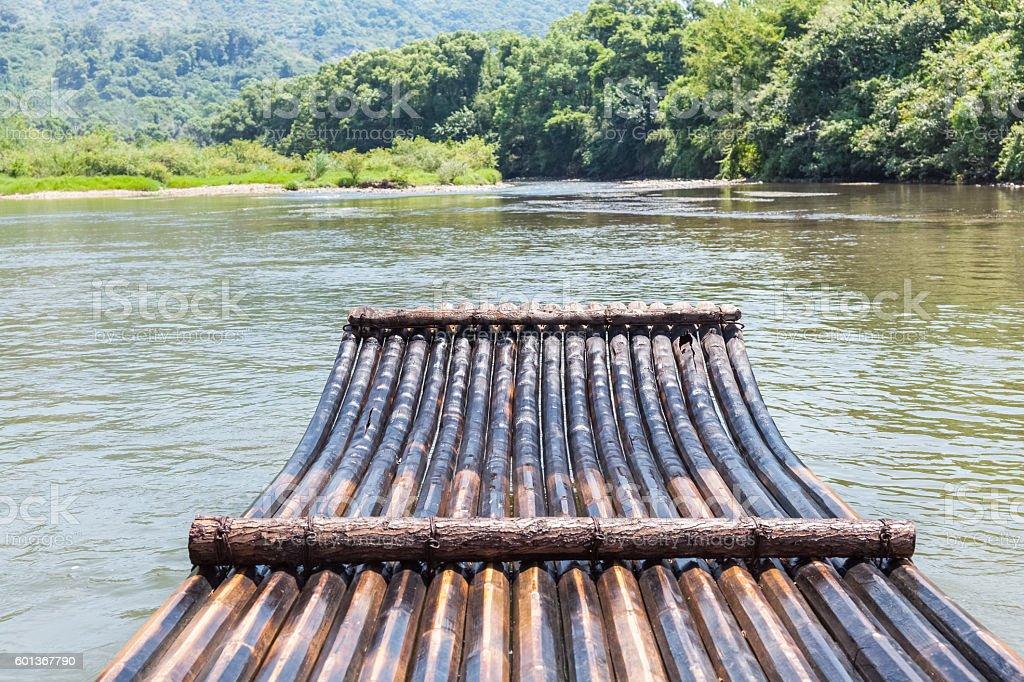 bamboo raft in the stream stock photo