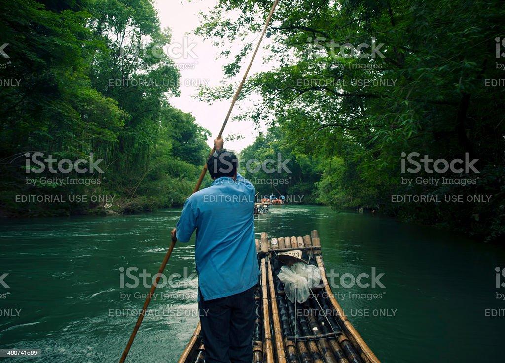 bamboo raft rower stock photo