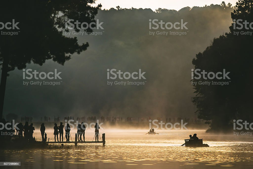 Bamboo rafting on river with sunlight enters stock photo