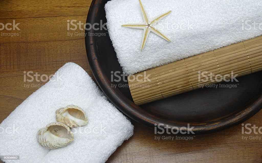 bamboo roll with shells and sea star stock photo