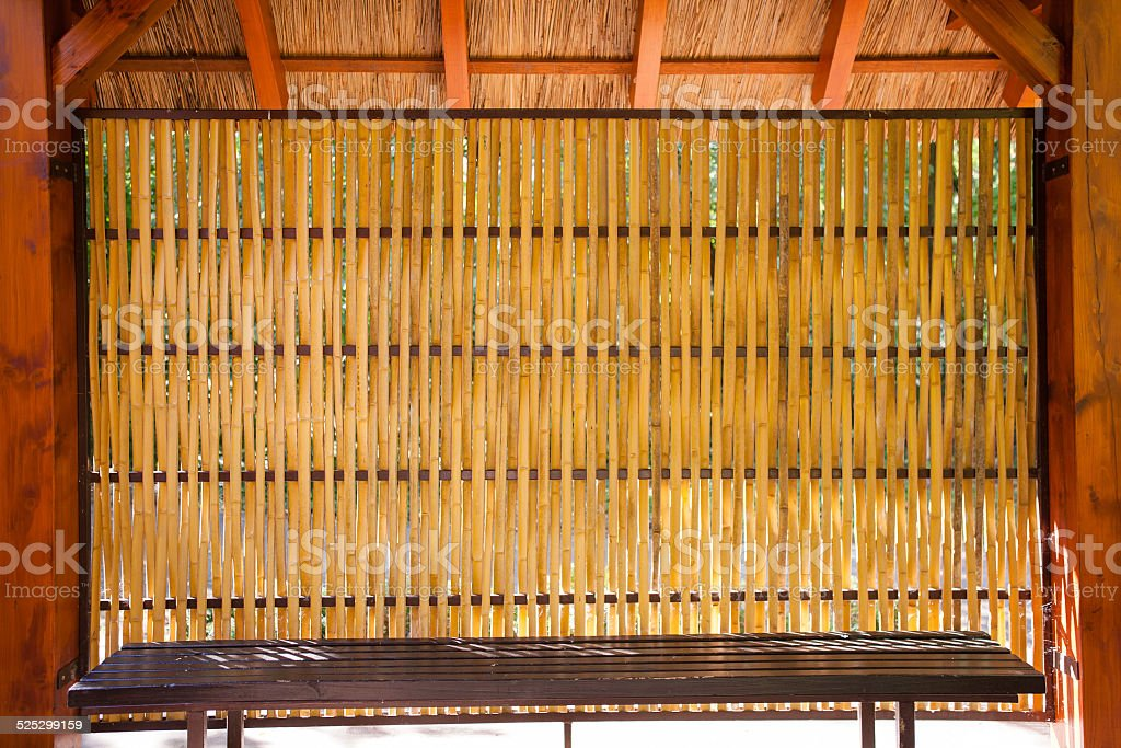Bamboo shelter sitting stock photo