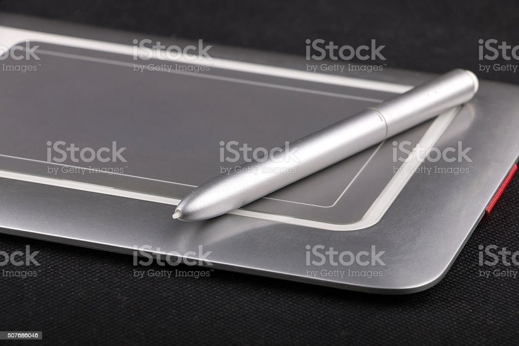 Bamboo small size pen tablet with stilus stock photo
