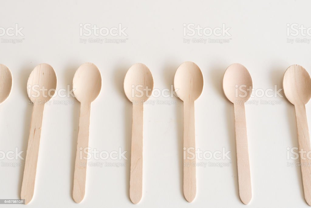 Bamboo spoons on table stock photo