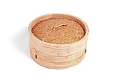 Bamboo steamer with closed lid on white background