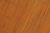 Orange toned straw mat surface. Abstract background and texture for design.