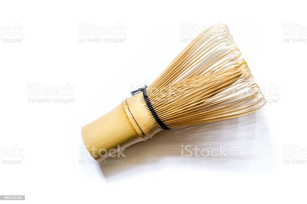 Bamboo tea whisk for matcha on white background, traditional culture of Japanese matcha tea stock photo