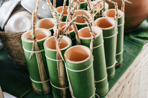 Bamboo tube can be used as a glass to drink water.Use for background.Ecological bamboo tube for drinking water, Concept to reduce global warming