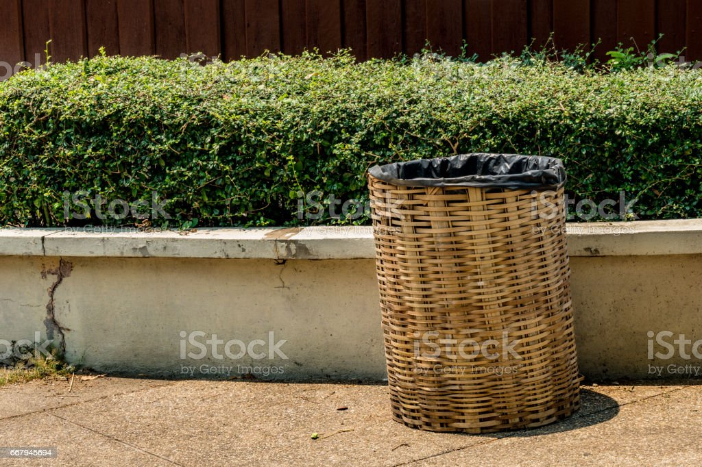 Bamboo weave trash can stock photo