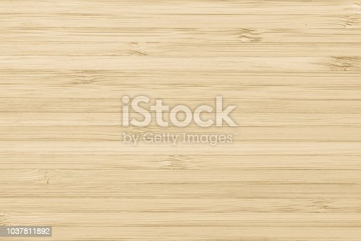 Bamboo wood texture background in natural light yellow cream color