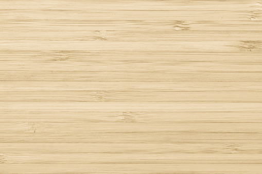 istock Bamboo wood texture background in natural light yellow cream color 1037811892