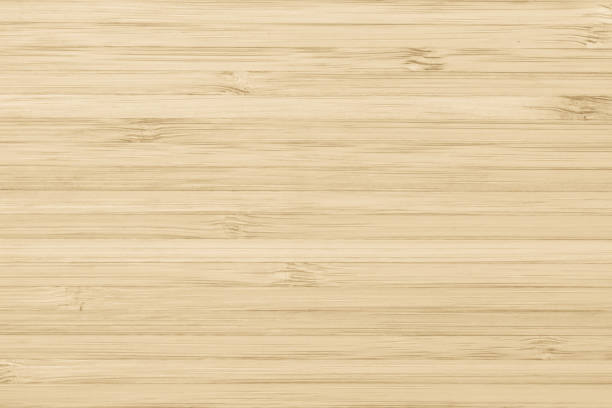 bamboo wood texture background in natural light yellow cream color - бамбук стоковые фото и изображения
