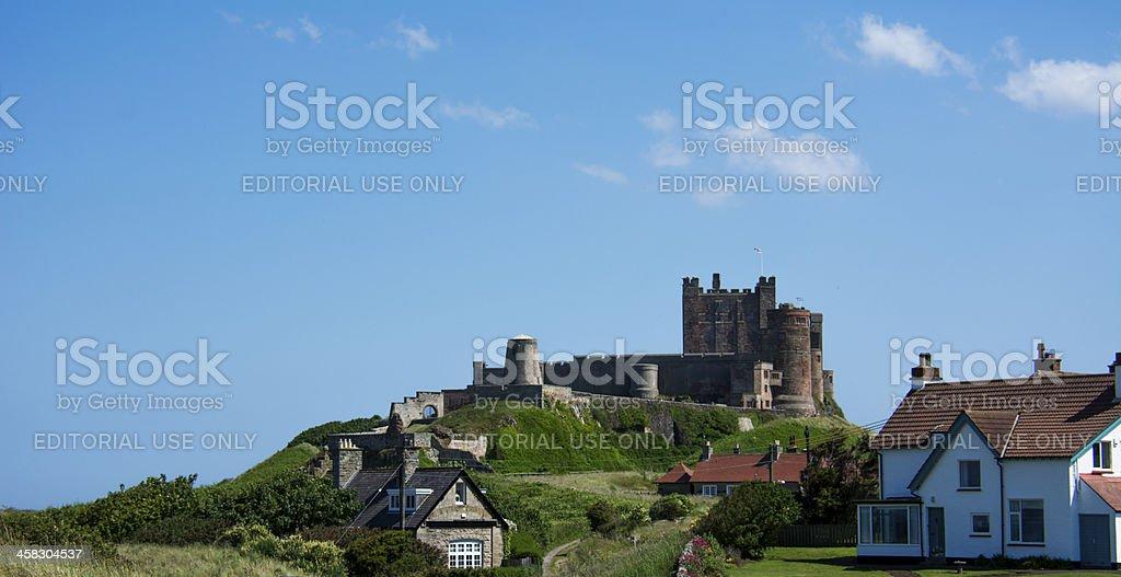 Bamburgh Castle against a vibrant blue sky royalty-free stock photo