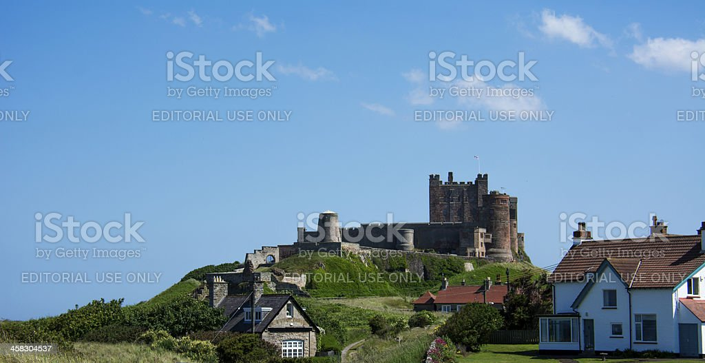 Bamburgh Castle against a vibrant blue sky stock photo