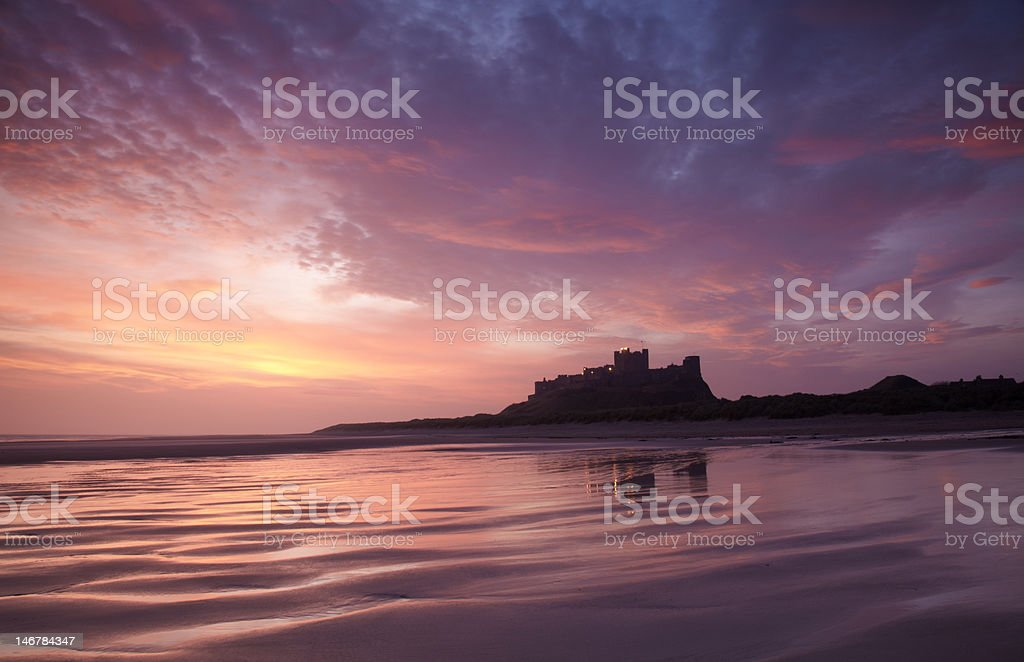Bamburgh Castle and sands stock photo