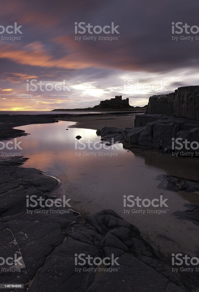Bamburgh Castle and shoreline stock photo