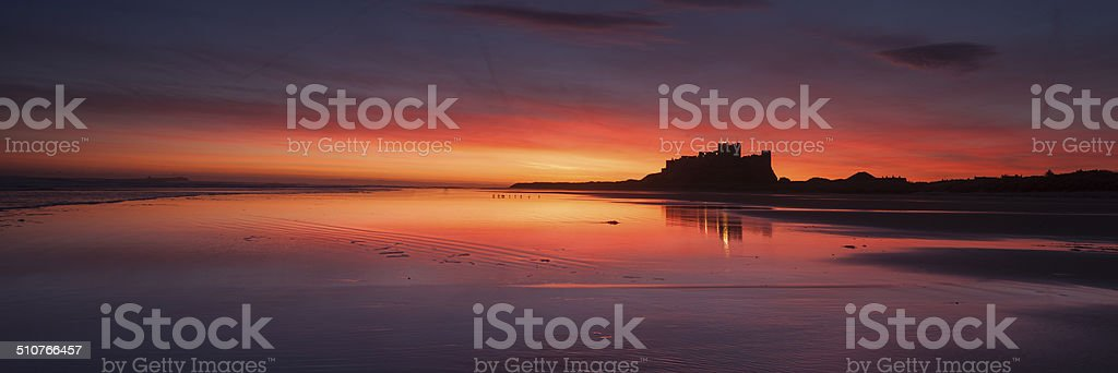 Bamburgh Castle at Dawn, Nortumberland, UK stock photo