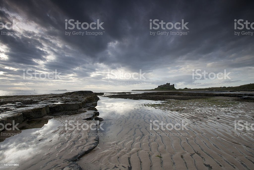 Bamburgh Castle at Dawn stock photo
