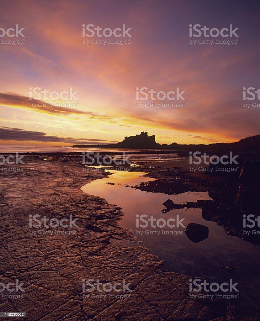 Bamburgh castle at sunrise royalty-free stock photo