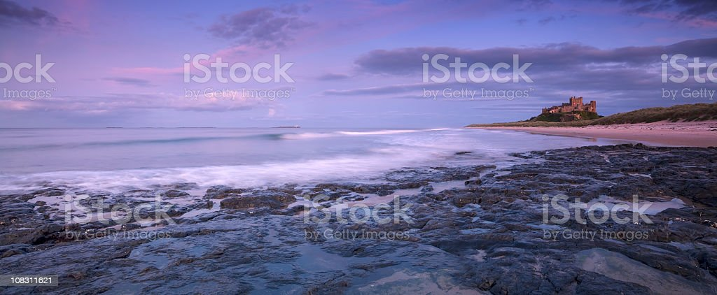 Bamburgh Castle at Sunset stock photo
