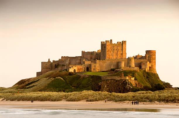 Bamburgh castle daytime with people walking on beach picture id157193180?b=1&k=6&m=157193180&s=612x612&w=0&h=1d2oahaq5jxmp6xsafjwj5tokzqtaxyz7f9ks yxtts=