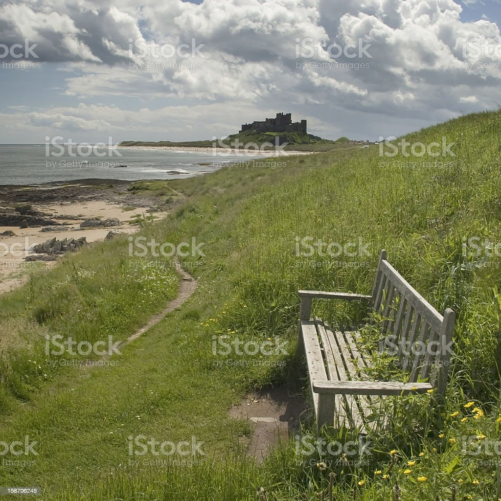 Bamburgh Castle with bench for viewing royalty-free stock photo