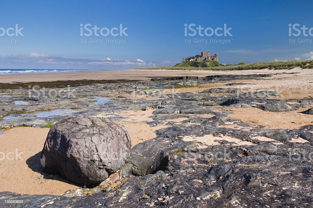 Bamburgh Castle with Rocks royalty-free stock photo