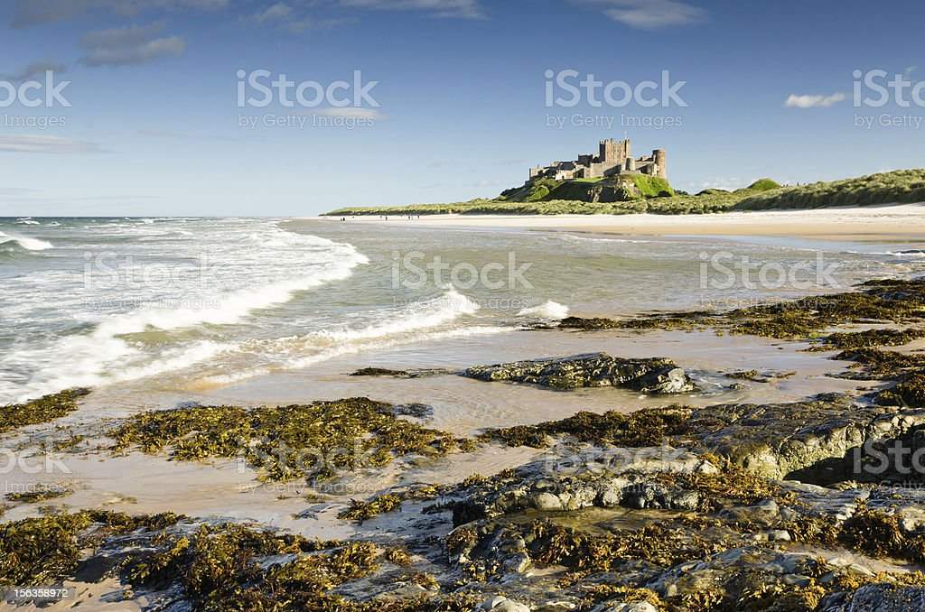 Bamburgh Castle with waves royalty-free stock photo