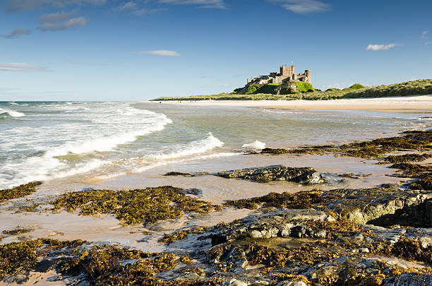 Bamburgh Castle with waves stock photo