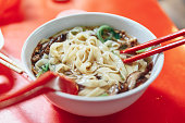 Ban Mian is a popular noodle dish, consisting of handmade noodles with flat egg served in soup or dried with vegetables, anchovy and fish or meat in Kuala Lumpur, Malaysia.