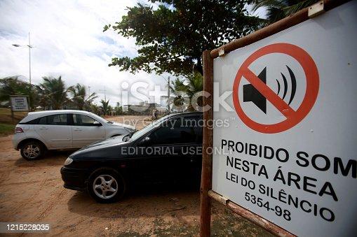 salvador, bahia / brazil - june 9, 2015: plaque informs about automotive sound prohibition in the Farol de Itapua beach region in the city of Salvador.