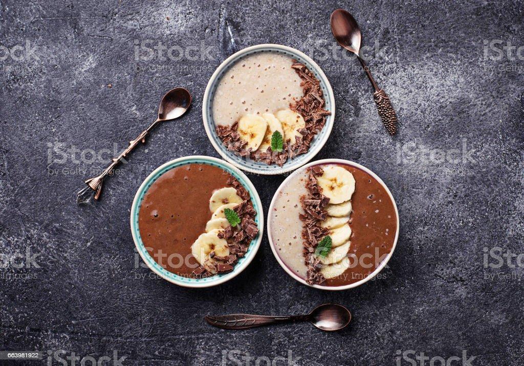 Banana and chocolate smoothie bowl stock photo