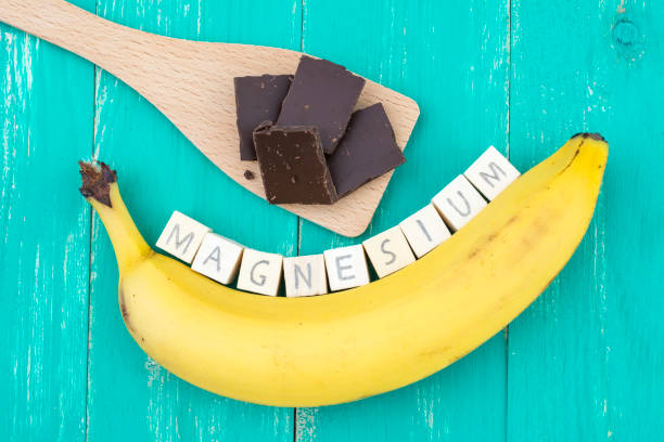 banana and dark chocolate containing lots of magnesium - magnesium stock photos and pictures
