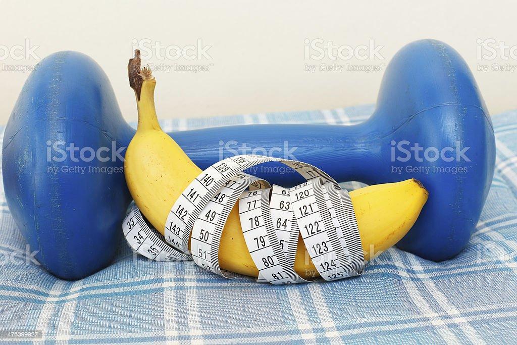 Banana and dumbbell royalty-free stock photo